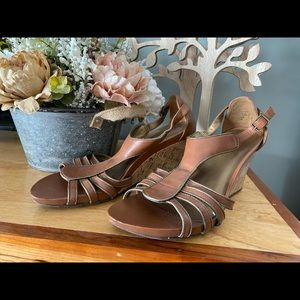 Mossimo gladiator wedges with gold trim.